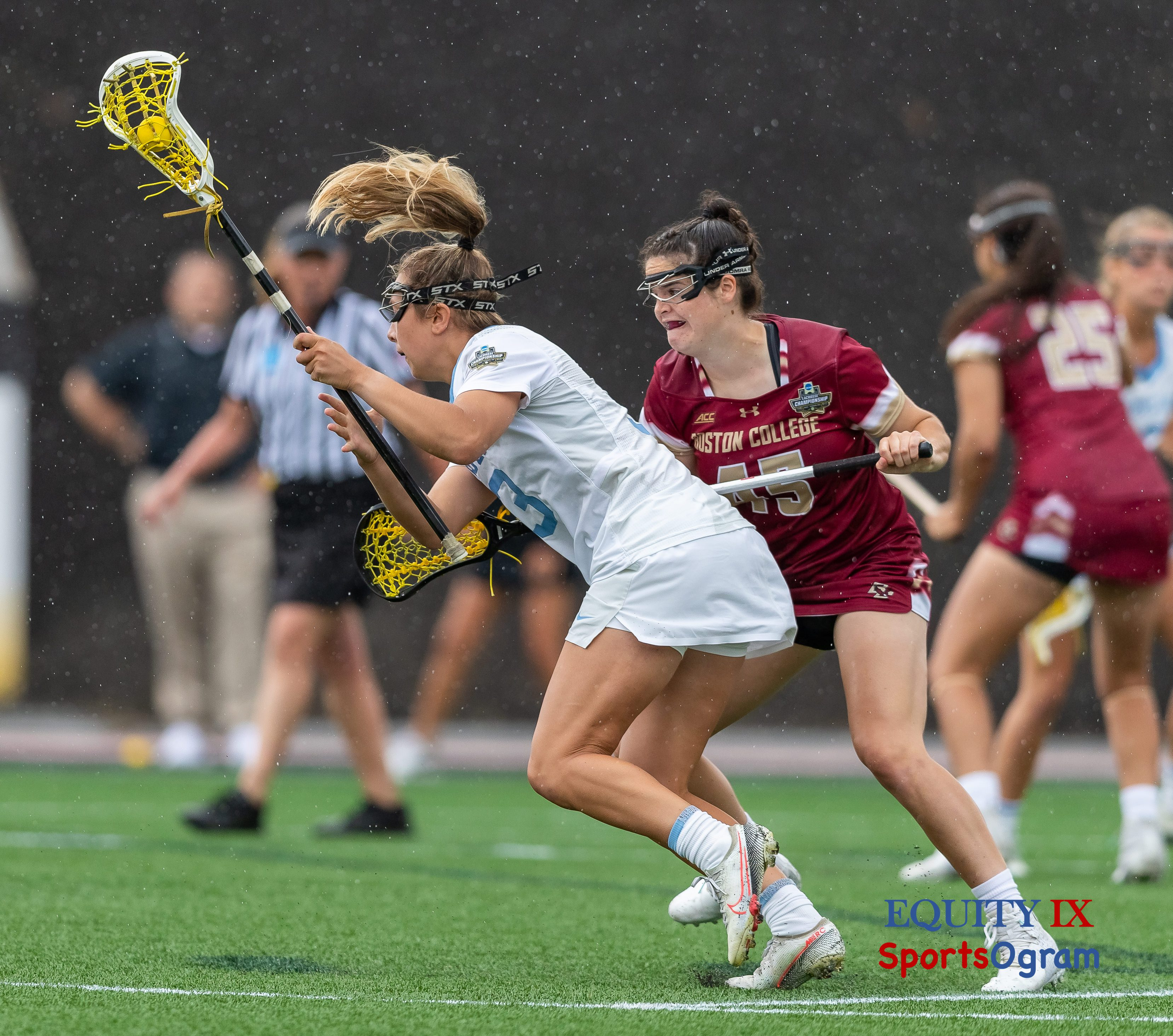 #45 Sydney Scales (Boston College defender) forces #3 Jamie Ortega (UNC) away from her dominant left side cradling yellow lacrosse ball one handed in the rain - 2021 NCAA Women's Lacrosse Final Four © Equity IX - SportsOgram - Leigh Ernst Friestedt