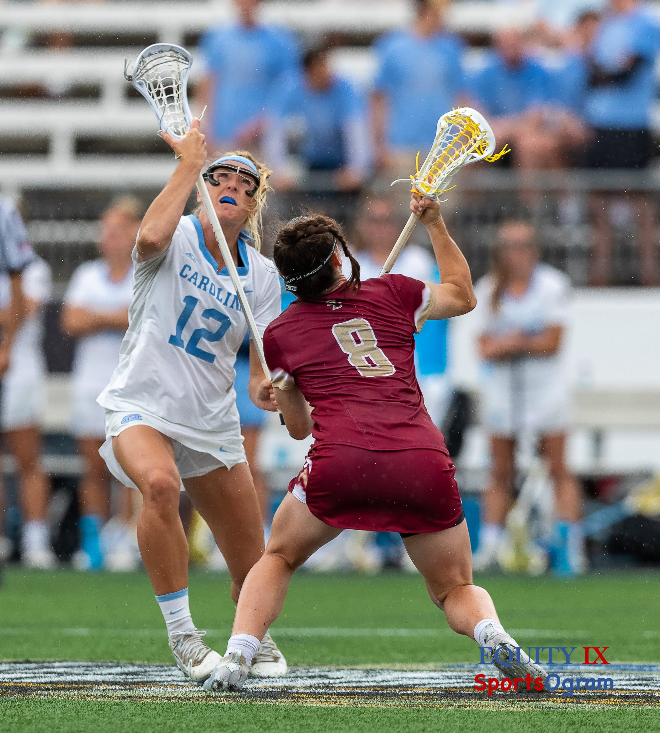 #12 Ally Mastroianni (UNC) draws against #8 Charlotte North (Boston College) both lacrosse sticks are in the air as the players look up for the ball - 2021 NCAA Women's Lacrosse Final Four © Equity IX - SportsOgram - Leigh Ernst Friestedt