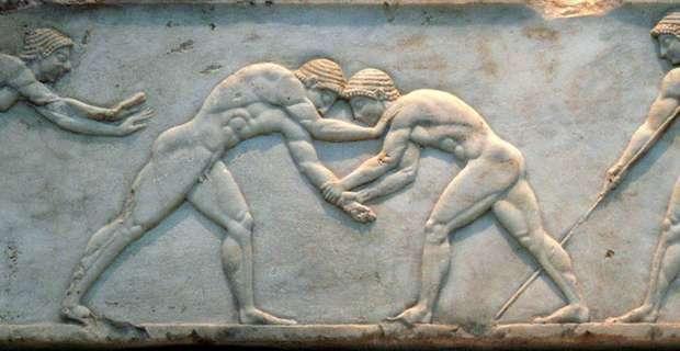 πάλη σε αρχαίο ανάγλυφο