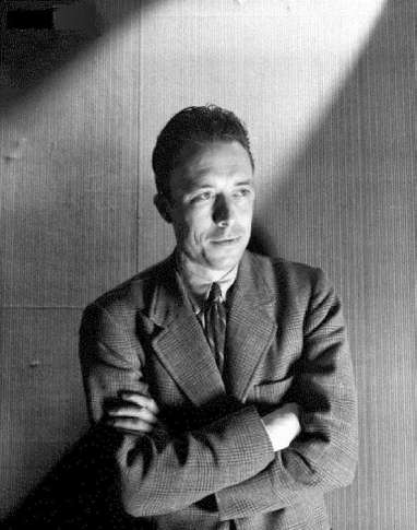 Circa June 1946, Paris, France --- French author and philosopher Albert Camus standing with his arms folded. Circa June 1946 --- Image by © Condé Nast Archive/Corbis