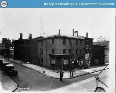 Original location of the city Morgue (Municipal Morgue) 13th & Wood Streets - A lone police officer stands in the street in front of the entrance - August 21st 1928