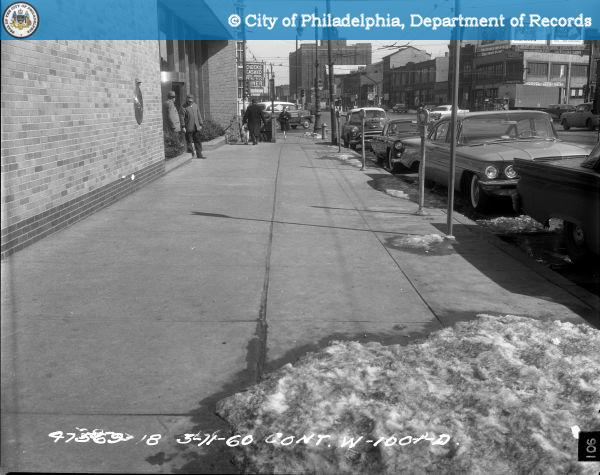 Cont. W-1001-D - Spring Garden Street-North Side - 13th Street to 12th Street: Sidewalk 1211-1207 Spring Garden Street East.