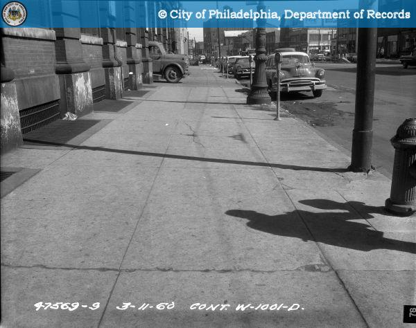 Cont. W-1001-D - Spring Garden Street-North Side - 13th Street to 12th Street: Sidewalk, 1217-1233 Street, 60' West of Driveway-East.