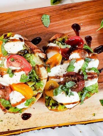 This Caprese Avocado Toast with Balsamic glaze recipe is delish! This toast is perfect for breakfast or brunch and is my favorite food. This toast also has fresh basil on top that adds a punch of flavor and makes this avocado toast the best!