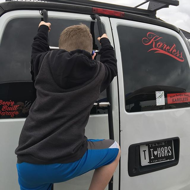 Hero climbing on top the #kareless van for a better view
