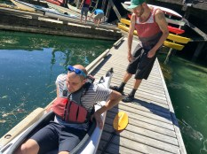 Enej getting setup on his kayak