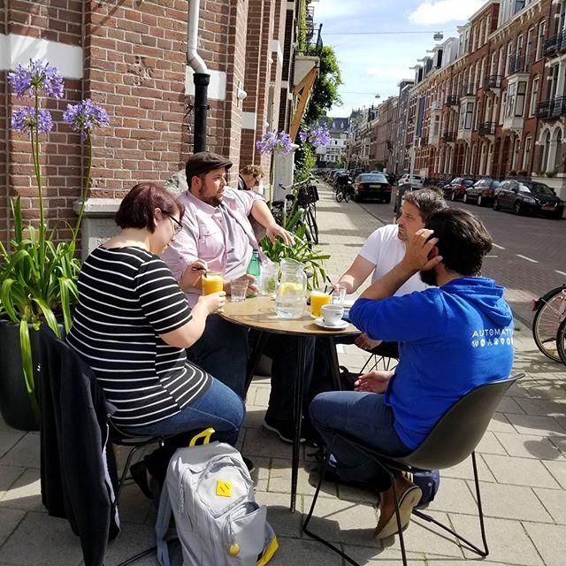 Jesse, Nicole, Richard, and Chris working outside a coffee shop.
