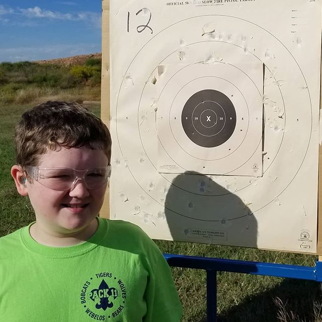 Hero by his target after using Roger Kroes' .22 with a red dot.