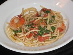 Spaghetti with big shrimp.