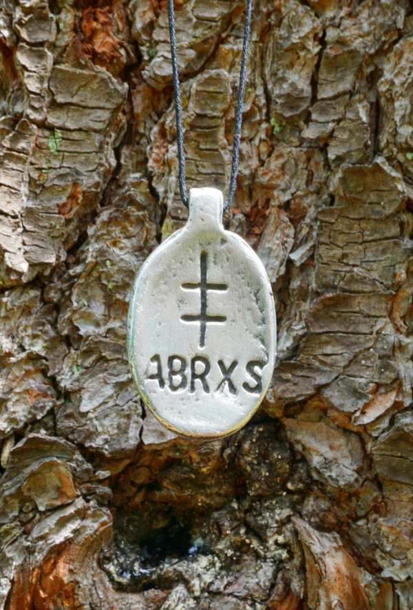 Abraxas amulet hangs from a tree
