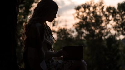 woman writing in journal to overcome postpartum depression