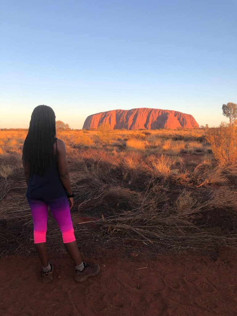 fitness travel blogger Erica Rascon explores Uluru at sunset