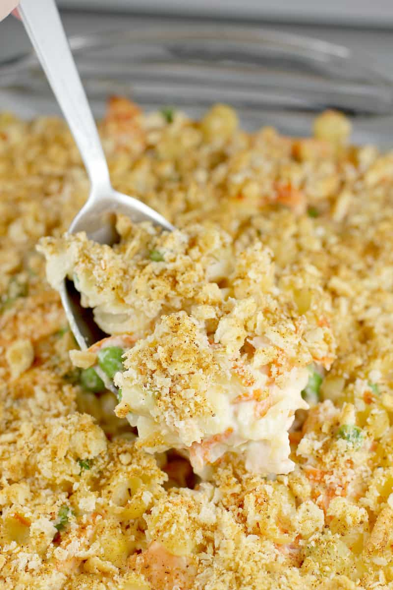cooked fresh salmon casserole with a large spoon scooping up some in the center