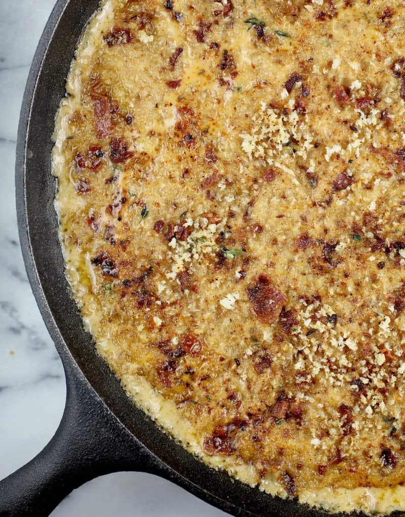 top down view of the cooked bacon macaroni and cheese in a large cast iron skillet