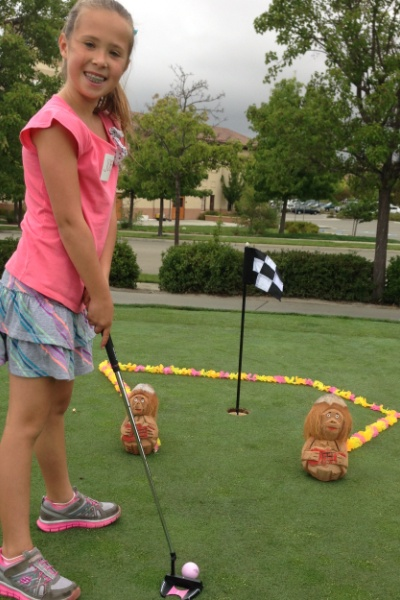 junior-girl-putting-bears-smile-600x400
