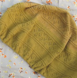 Open Sky shawl knitted in a mustard coloured wool