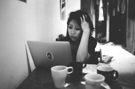 eric-kim-photography-cindy-project-black-and-white-4-paris-coffee-hand-stress-laptop