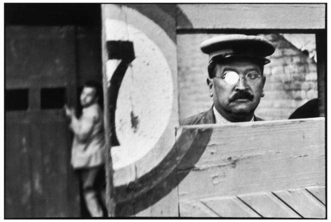 Photograph by Henri Cartier-Bresson. Note how the man in the right is out-of-focus. Yet it is still an effective photograph