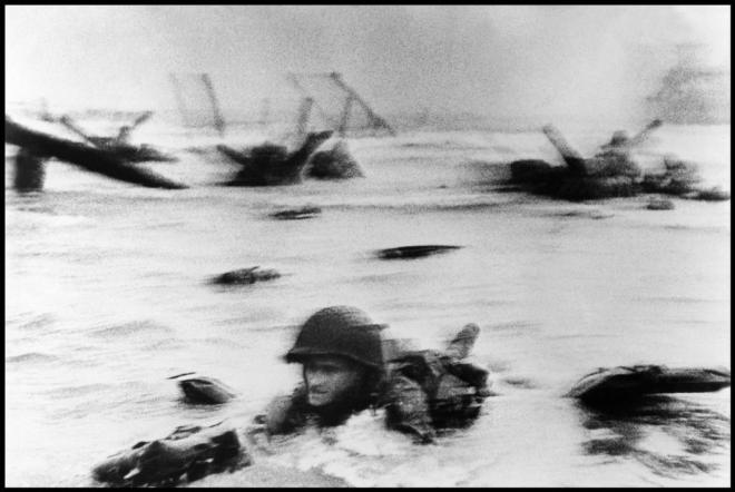 Robert Capa, striving to make the most intimate and memorable photos often put his life in danger. What resulted was photos that lasted a lifetime. Robert Capa © International Center of Photography FRANCE. Normandy. June 6th, 1944. Landing of the American troops on Omaha Beach.