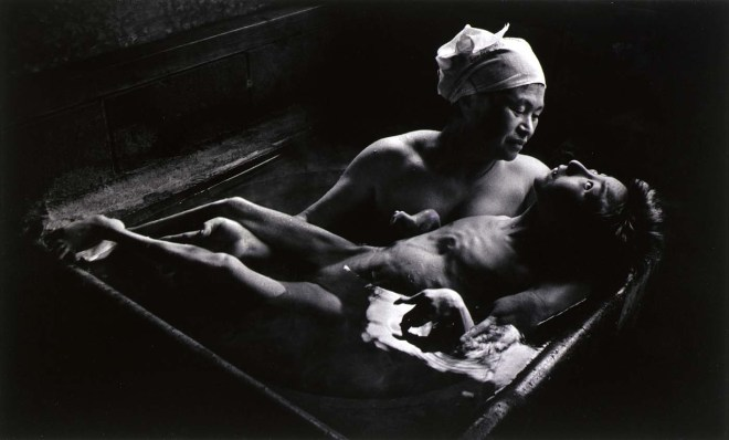 Tomoko in Her Bath, Mother and daughter with Minamata Disease, Japan. Copyright: Magnum Photos
