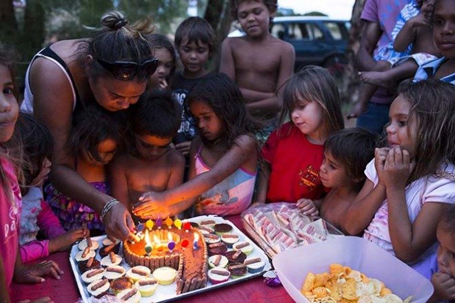 Five year old Akantia Jones (far right corner with her hands on her chin) watches intently as Larissa Jones (Left) and Kade Cattermore prepare to blow out candles to celebrate their shared sixth birthday. Only five days prior Akantia's father was murdered in the front yard of a neighbor. David Maurice Smith/Oculi.