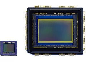 Old Ricoh GRDIV sensor size on left, Ricoh GRDV sensor on the right (compact vs APS-C sensors)