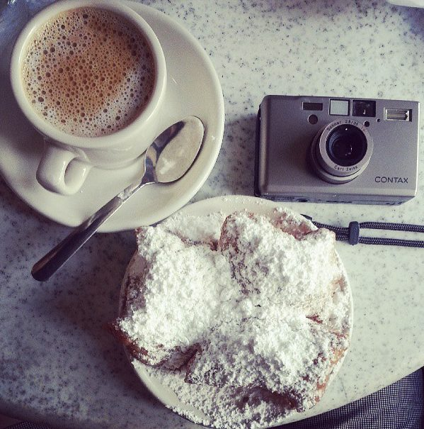 """Famous """"French"""" beignet and coffee in New Orleans. I had a small (but delicious) heart attack after eating it. Thanks Kenneth!"""