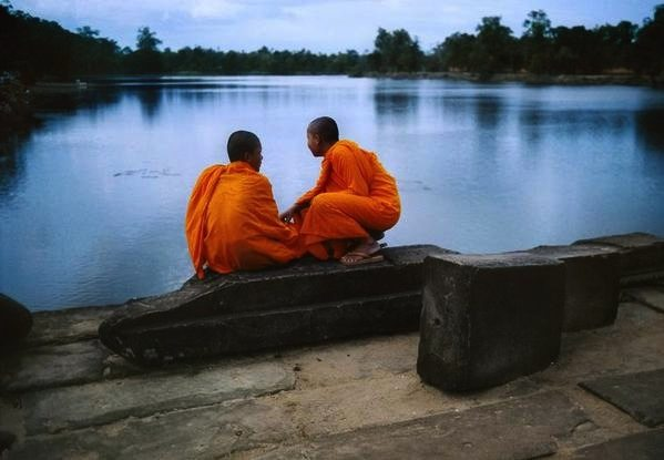 Steve McCurry. Once again, you can see how the bright orange of the monk's clothes perfectly complement the blue water.