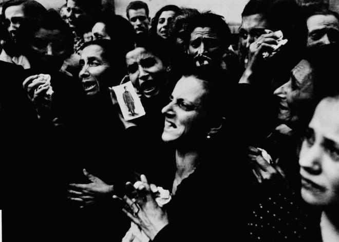 Robert Capa / Magnum Photos. ITALY. Naples. October 2, 1943. Women crying at funeral of twenty teenaged partisans who had fought the Germans before the Allies entered the city.