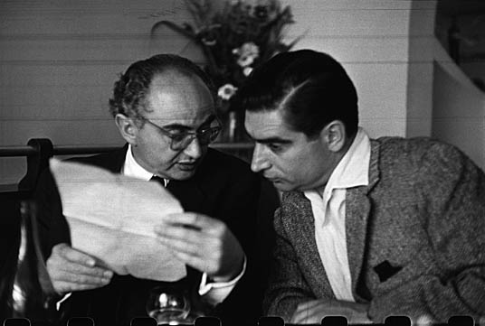 "FRANCE. Paris. The photographers David SEYMOUR ""Chim"" (left) and Robert CAPA. 1952."