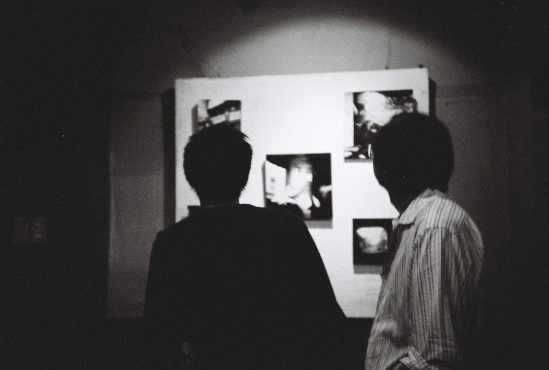 My dad looking at some of my works during an exhibit