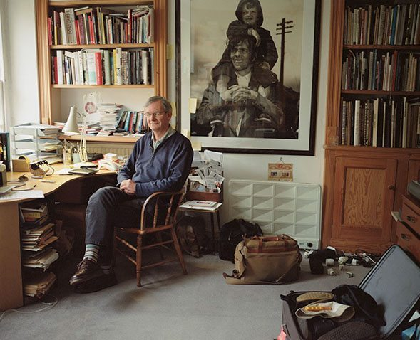 Martin Parr at home, where he houses some of his 12,000+ photo books