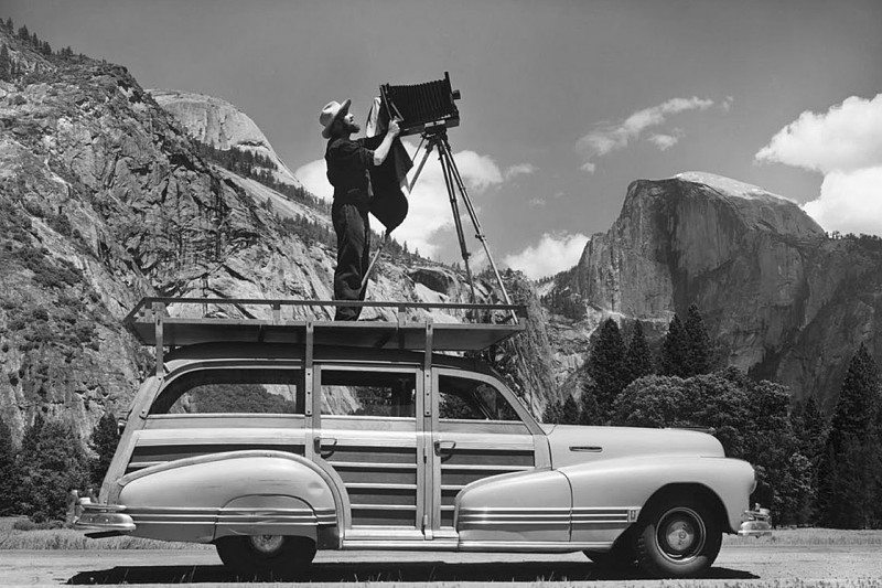 Ansel Adams shooting his large-format camera (on top of his car)