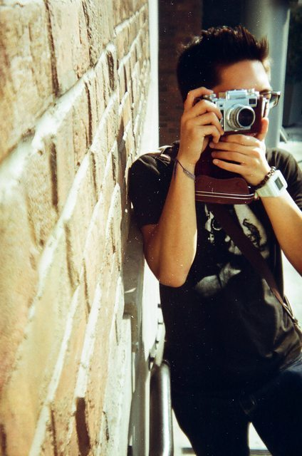 Junior year of college (2009), photo of me and my grandfather's old Contax III camera (photographed by my friend John Golden)