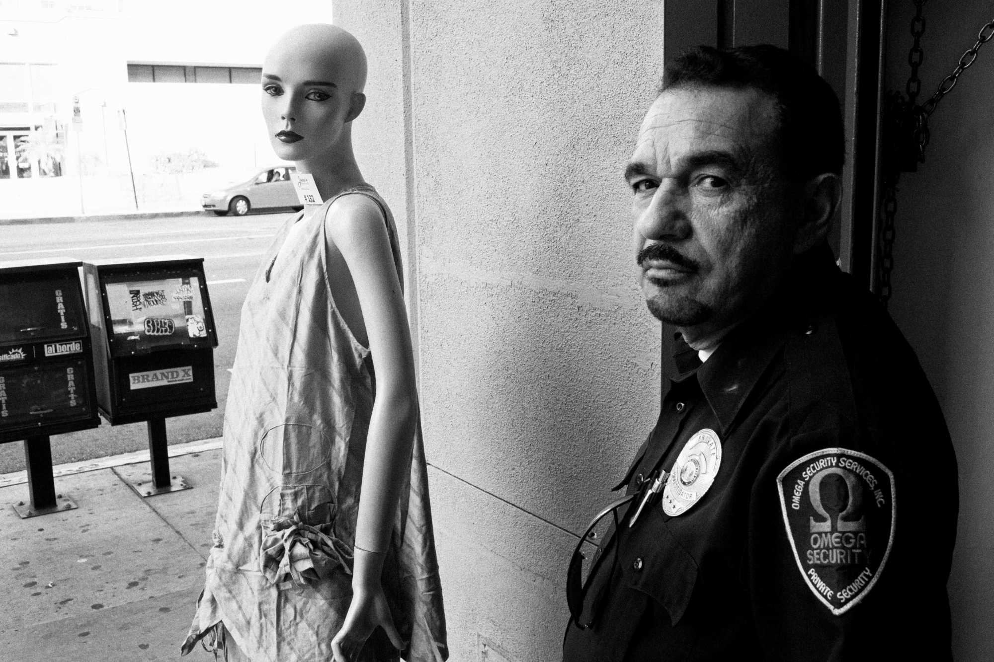 Downtown LA, 2012. Canon 5D, 35mm lens. Juxtaposition between security guard and mannequin.