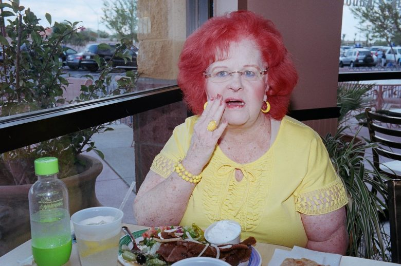 eric kim street photography - tucson- red lady - yellow - only in america - kodak portra 400