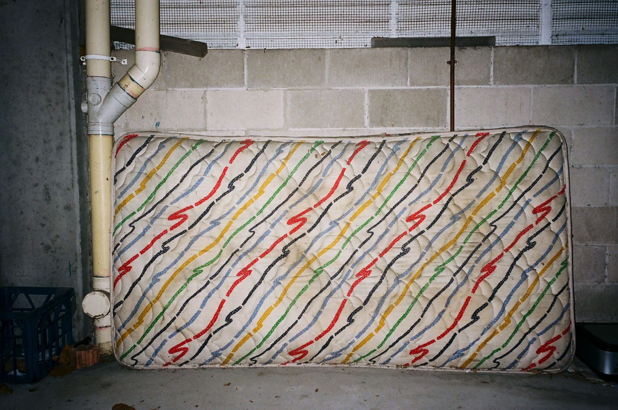 Eric Kim / Melbourne, 2012. A photograph of a colorful mattress I saw in a garage.