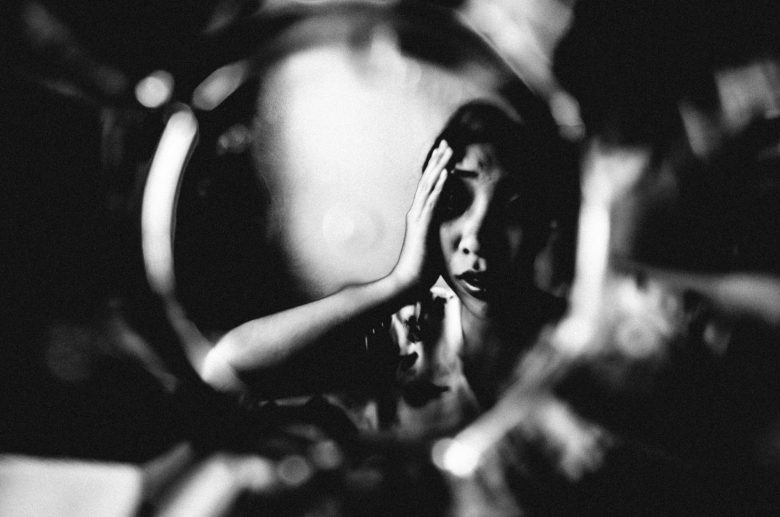 eric-kim-photography-cindy-project-black-and-white-11-stress-anxiety-hand-glass