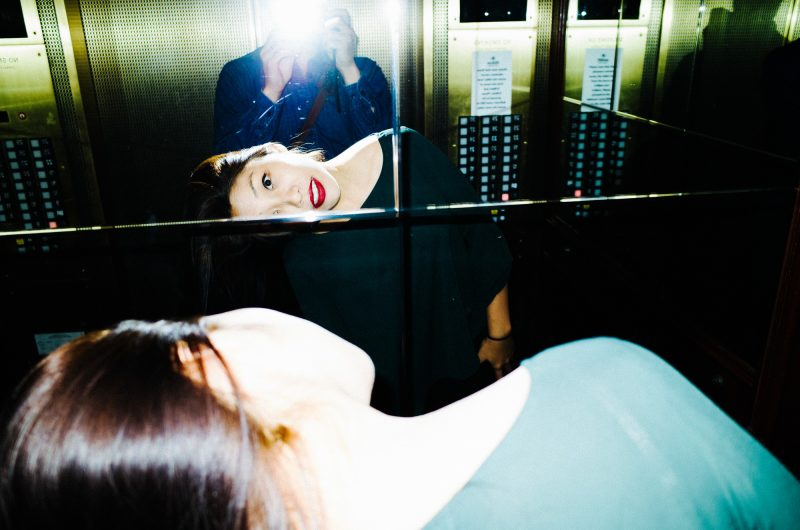 eric kim photography - Cindy Project - color-6 mirror reflection san francisco elevator