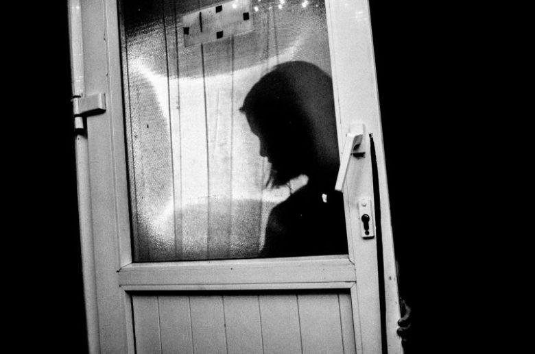 eric kim black and white street photography door silhouette hanoi
