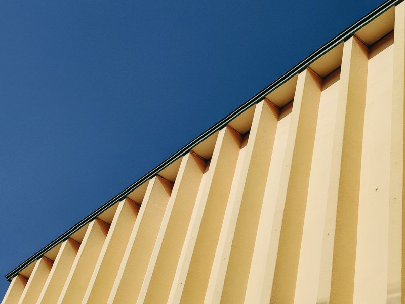 Yellow wall architecture, blue sky.