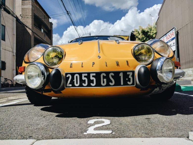 Yellow car, blue sky.