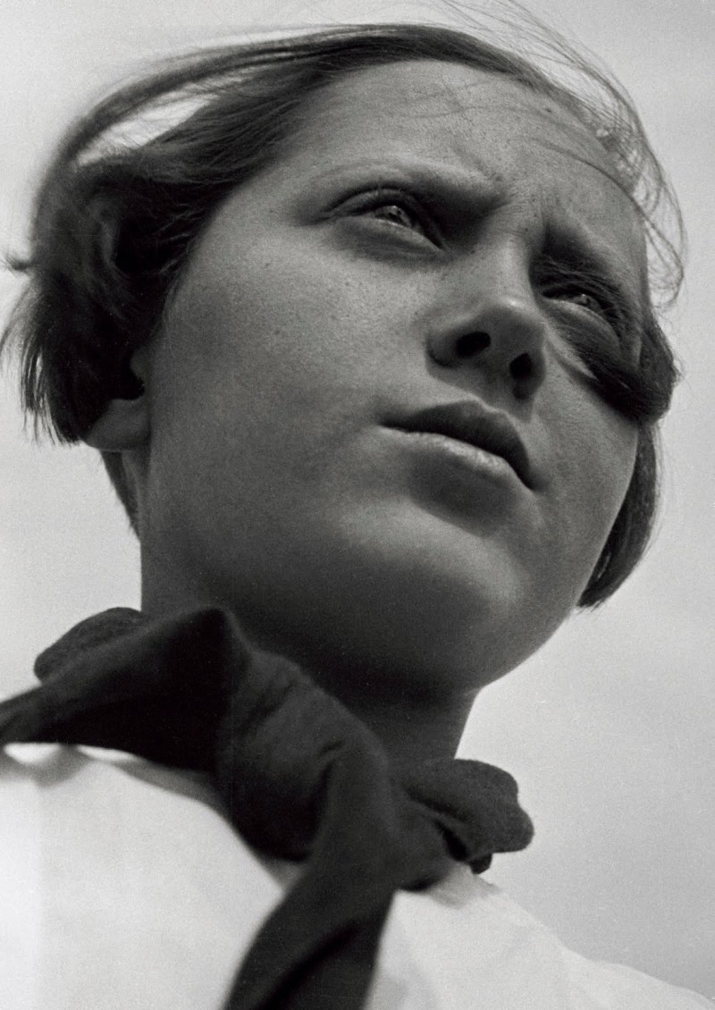 IPhoto by Rodchenko. Note his low angle of the girl, makes her look more powerful.
