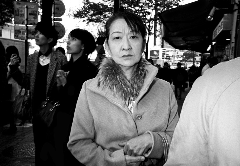 Pensive woman and hands. Tokyo, 2011.