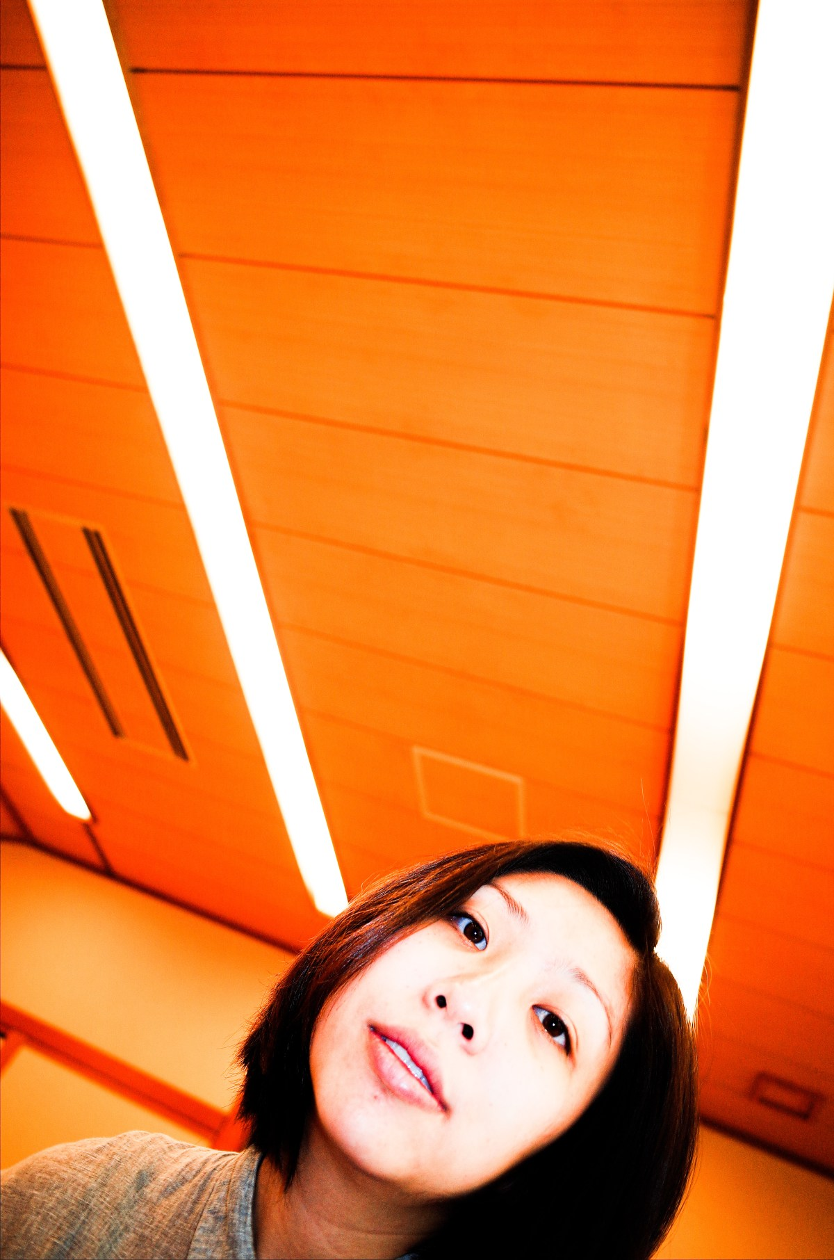 Portrait of Cindy, shot from a super-low angle with 28mm on RICOH GR II. Uji, Kyoto 2017. Note the leading lines in the top of the frame.