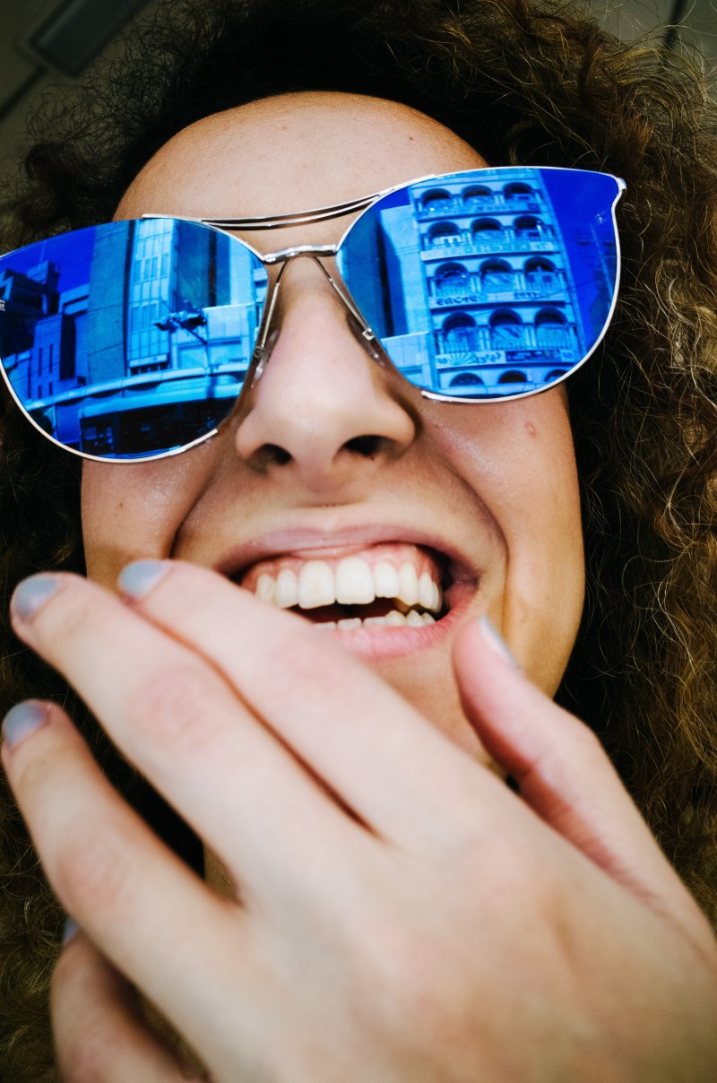 Girl laughing with blue sunglasss. Kyoto, 2017.