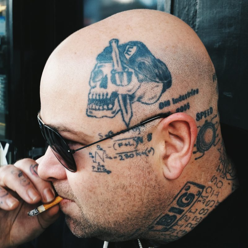 Head tattoo.