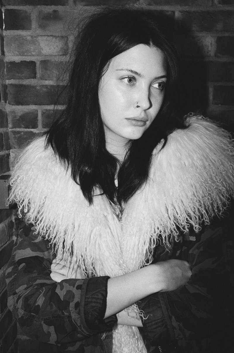 London, 2015. Leica MP, 35mm f/2 Summicron, flash, yellow filter. Woman with fur and crossed arms. London, 2015