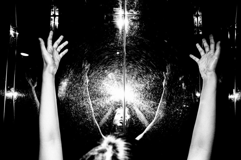 Cindy creator. Hands, reflection, flash, elevator, Saigon.