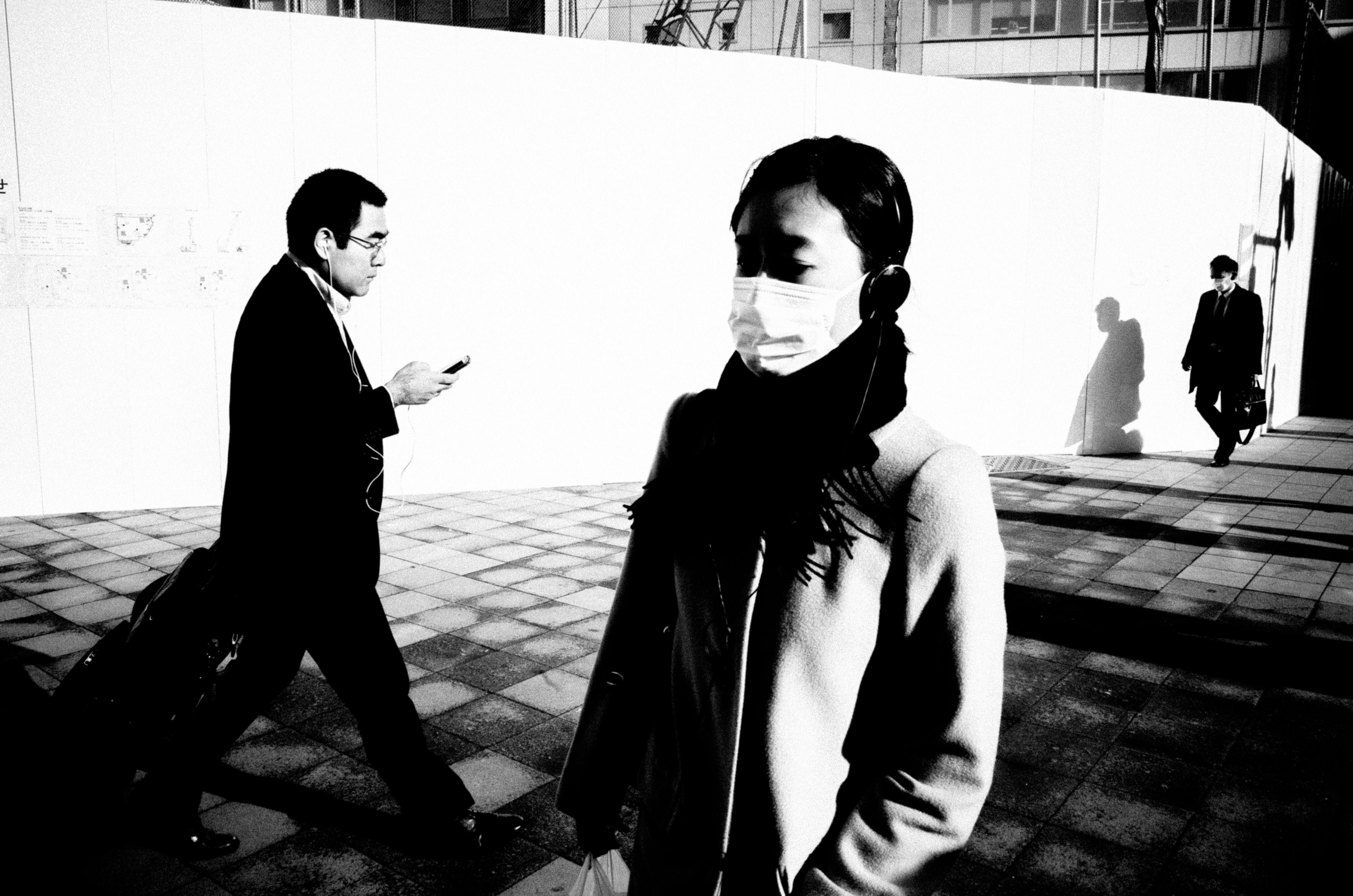 People walking at cross walk. Tokyo, 2016